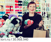 Купить «Woman holding shopping bags and accessories for knitting and embroidery», фото № 30968940, снято 10 мая 2017 г. (c) Яков Филимонов / Фотобанк Лори
