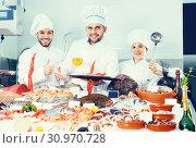 Купить «Positive team of professional cooks near seafood», фото № 30970728, снято 26 января 2018 г. (c) Яков Филимонов / Фотобанк Лори