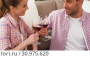 Купить «happy couple drinking red wine at home», видеоролик № 30975620, снято 10 июня 2019 г. (c) Syda Productions / Фотобанк Лори