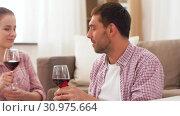 Купить «happy couple drinking red wine at home», видеоролик № 30975664, снято 10 июня 2019 г. (c) Syda Productions / Фотобанк Лори