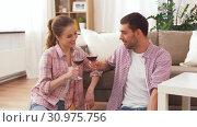 Купить «happy couple drinking red wine at home», видеоролик № 30975756, снято 10 июня 2019 г. (c) Syda Productions / Фотобанк Лори