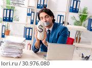 Купить «Young male employee with tape on the mouth», фото № 30976080, снято 13 декабря 2018 г. (c) Elnur / Фотобанк Лори