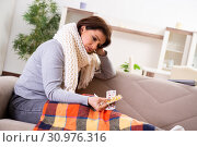 Sick middle-aged woman suffering at home. Стоковое фото, фотограф Elnur / Фотобанк Лори