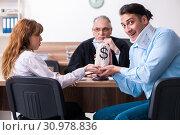 Купить «Young couple in the courthouse in divorce concept», фото № 30978836, снято 28 марта 2019 г. (c) Elnur / Фотобанк Лори