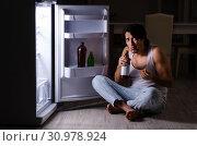 Купить «Man breaking diet at night near fridge», фото № 30978924, снято 8 февраля 2019 г. (c) Elnur / Фотобанк Лори