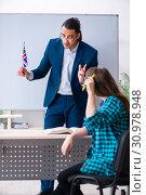 Купить «Male english teacher and female student in the classroom», фото № 30978948, снято 1 апреля 2019 г. (c) Elnur / Фотобанк Лори