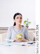 Купить «Young woman in budget planning concept», фото № 30979304, снято 8 января 2019 г. (c) Elnur / Фотобанк Лори