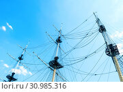 Купить «Travel landscape - ship masts with rigging on the background of the blue summer sky. Concept of sea travel», фото № 30985316, снято 6 июня 2019 г. (c) Зезелина Марина / Фотобанк Лори