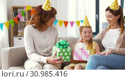 Купить «family greeting girl with birthday at home party», видеоролик № 30985416, снято 14 июня 2019 г. (c) Syda Productions / Фотобанк Лори