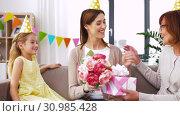 Купить «daughter with gift box greeting mother on birthday», видеоролик № 30985428, снято 14 июня 2019 г. (c) Syda Productions / Фотобанк Лори