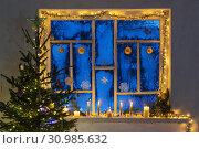 Купить «Christmas decorations on old wooden window», фото № 30985632, снято 9 января 2019 г. (c) Майя Крученкова / Фотобанк Лори