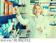Female pharmacist in drugstore. Стоковое фото, фотограф Яков Филимонов / Фотобанк Лори