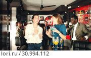 Купить «Young attractive women with cocktails having fun with workmates on office party at nightclub», видеоролик № 30994112, снято 12 апреля 2019 г. (c) Яков Филимонов / Фотобанк Лори