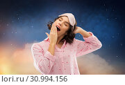 Купить «happy young woman in pajama and eye sleeping mask», фото № 30994156, снято 6 марта 2019 г. (c) Syda Productions / Фотобанк Лори