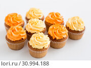 Купить «cupcakes with frosting on white background», фото № 30994188, снято 6 июля 2018 г. (c) Syda Productions / Фотобанк Лори