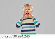 Купить «little boy in striped pullover calling someone», фото № 30994240, снято 9 марта 2019 г. (c) Syda Productions / Фотобанк Лори