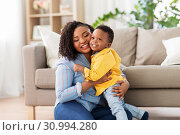 Купить «happy african american mother with baby at home», фото № 30994280, снято 22 марта 2019 г. (c) Syda Productions / Фотобанк Лори