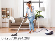 Купить «woman or housewife with vacuum cleaner at home», фото № 30994288, снято 7 апреля 2019 г. (c) Syda Productions / Фотобанк Лори