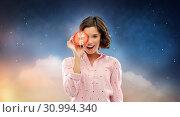 Купить «happy young woman in pajama with alarm clock», фото № 30994340, снято 6 марта 2019 г. (c) Syda Productions / Фотобанк Лори