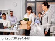 Купить «colleague seeing off fired employee leaving office», фото № 30994448, снято 23 марта 2019 г. (c) Syda Productions / Фотобанк Лори