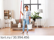Купить «african woman or housewife cleaning floor at home», фото № 30994456, снято 7 апреля 2019 г. (c) Syda Productions / Фотобанк Лори
