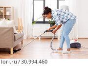 Купить «woman or housewife with vacuum cleaner at home», фото № 30994460, снято 7 апреля 2019 г. (c) Syda Productions / Фотобанк Лори