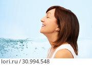 Купить «profile of smiling senior woman over blue water», фото № 30994548, снято 8 февраля 2019 г. (c) Syda Productions / Фотобанк Лори