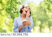 Купить «woman in pajama and eye mask with coffee yawning», фото № 30994756, снято 6 марта 2019 г. (c) Syda Productions / Фотобанк Лори