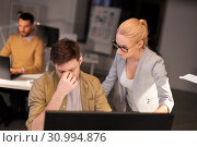 Купить «business team with computer working late at office», фото № 30994876, снято 26 ноября 2017 г. (c) Syda Productions / Фотобанк Лори