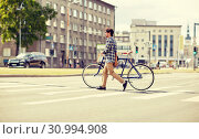 Купить «young man with fixed gear bicycle on crosswalk», фото № 30994908, снято 15 июня 2016 г. (c) Syda Productions / Фотобанк Лори