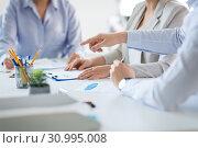 Купить «business team discussing charts at office», фото № 30995008, снято 28 марта 2018 г. (c) Syda Productions / Фотобанк Лори