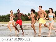 Купить «happy friends running on summer beach», фото № 30995032, снято 29 июля 2018 г. (c) Syda Productions / Фотобанк Лори