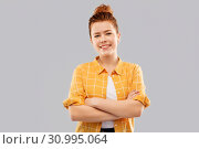Купить «smiling red haired teenage girl with crossed arms», фото № 30995064, снято 28 февраля 2019 г. (c) Syda Productions / Фотобанк Лори