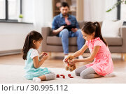 Купить «girls playing with toy crockery and teddy at home», фото № 30995112, снято 31 марта 2019 г. (c) Syda Productions / Фотобанк Лори