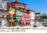 Купить «Tenement houses on Ribeira Square in Porto city on Iberian Peninsula, second largest city in Portugal», фото № 30995972, снято 17 июля 2018 г. (c) Николай Коржов / Фотобанк Лори