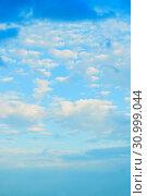 Купить «Sunset colorful sky background - blue dramatic colorful clouds lit by evening sunshine», фото № 30999044, снято 3 июня 2015 г. (c) Зезелина Марина / Фотобанк Лори