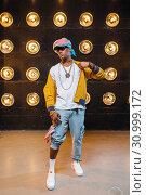 Купить «Black rapper in cap, perfomance on stage», фото № 30999172, снято 5 апреля 2019 г. (c) Tryapitsyn Sergiy / Фотобанк Лори