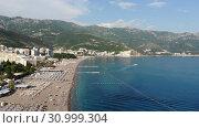 Купить «Becici, Montenegro - June 12.2019. Beautiful top view of the beach with people.», видеоролик № 30999304, снято 17 октября 2019 г. (c) Володина Ольга / Фотобанк Лори