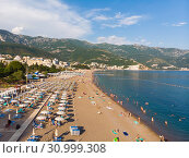 Купить «Becici, Montenegro - June 12.2019. Beautiful top view of the beach with people.», фото № 30999308, снято 11 июня 2019 г. (c) Володина Ольга / Фотобанк Лори