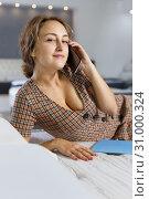 Купить «Smiling woman lying on bed and talking on phone», фото № 31000324, снято 22 октября 2018 г. (c) Яков Филимонов / Фотобанк Лори