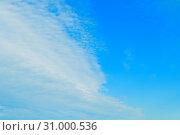 Купить «Blue colorful sky background - blue dramatic colorful clouds lit by evening sunshine», фото № 31000536, снято 31 мая 2015 г. (c) Зезелина Марина / Фотобанк Лори