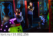 Купить «Parents and children playing laser tag», фото № 31002256, снято 6 июня 2018 г. (c) Яков Филимонов / Фотобанк Лори