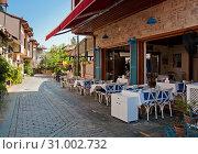 Купить «Antalya, Turkey - September 22, 2018: Street of old town Kaleici in Antalya, Turkey», фото № 31002732, снято 22 сентября 2018 г. (c) Наталья Двухимённая / Фотобанк Лори