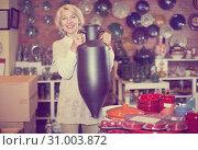 Купить «Woman posing with ceramic tableware», фото № 31003872, снято 31 октября 2016 г. (c) Яков Филимонов / Фотобанк Лори