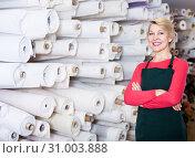 Купить «Seller displaying various fabrics», фото № 31003888, снято 15 февраля 2017 г. (c) Яков Филимонов / Фотобанк Лори