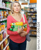 Купить «Pensive female shopping at store», фото № 31004024, снято 8 февраля 2019 г. (c) Яков Филимонов / Фотобанк Лори