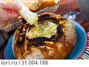 Купить «French cuisine, camembert cheese melted in fresh bread», фото № 31004188, снято 15 июля 2020 г. (c) Яков Филимонов / Фотобанк Лори