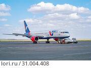 Aircraft Boeing 757 for pre-flight maintenance. Orenburg, Russia - May 04, 2019: A turbofan airliner Azurair company in the Orenburg airport Gagarin. Редакционное фото, фотограф Вадим Орлов / Фотобанк Лори