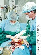 Купить «surgeons perfoming abdominal cesarean section», фото № 31004816, снято 5 февраля 2014 г. (c) Дмитрий Калиновский / Фотобанк Лори