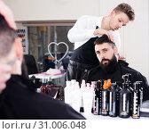 Купить «Client looking displeased about new haircut», фото № 31006048, снято 27 января 2017 г. (c) Яков Филимонов / Фотобанк Лори